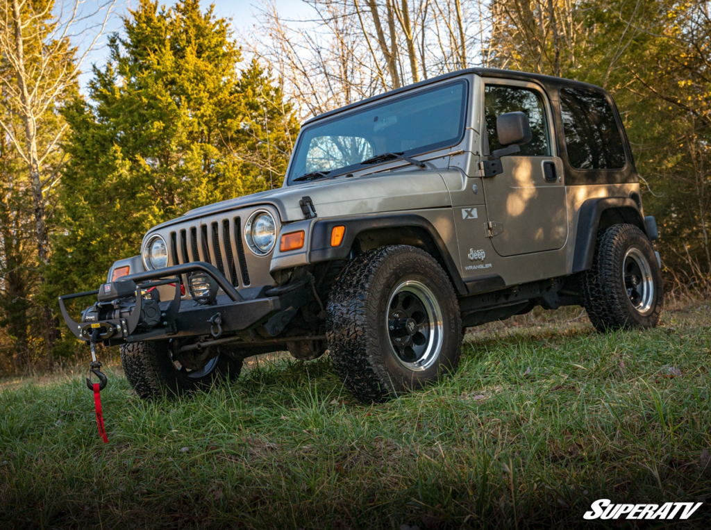 SuperATV's 12,000 lb. Black Ops Winch installed on the front of a Jeep