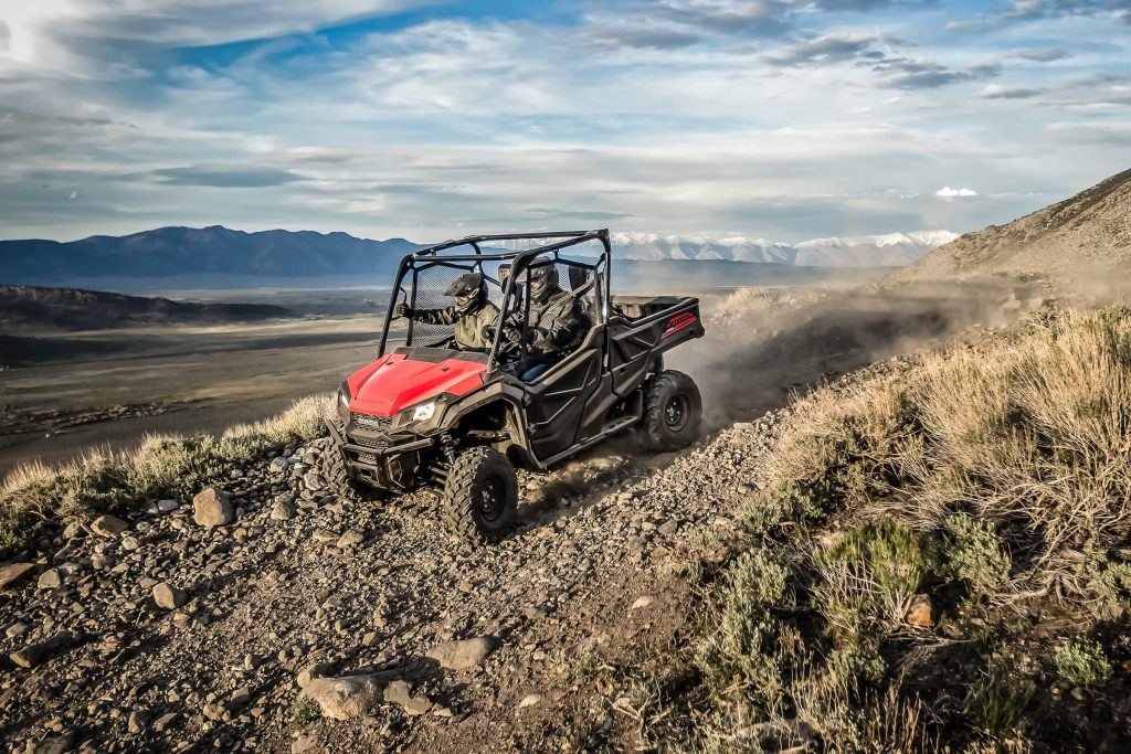 A Honda Pioneer 1000 reaching top speed on a rocky trail