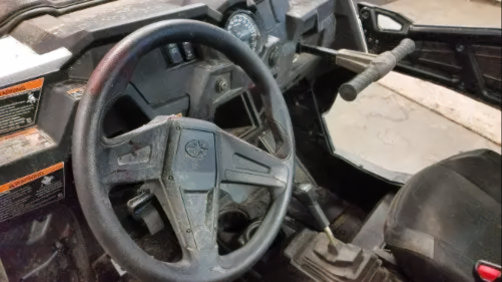 A bloody RZR steering wheel following his UTV accident