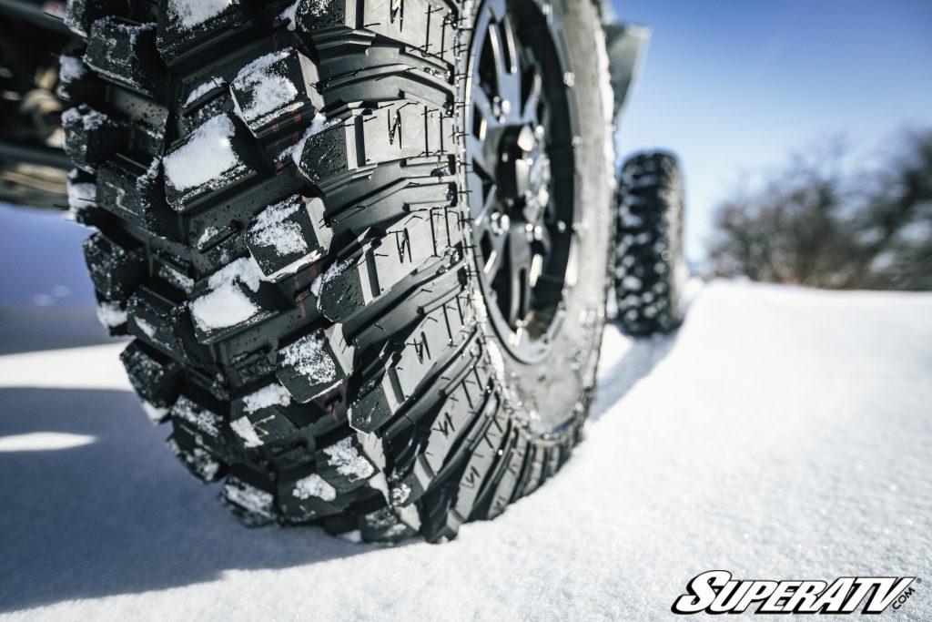 A close-up shot of SuperATV's XT Warrior Tires on snow