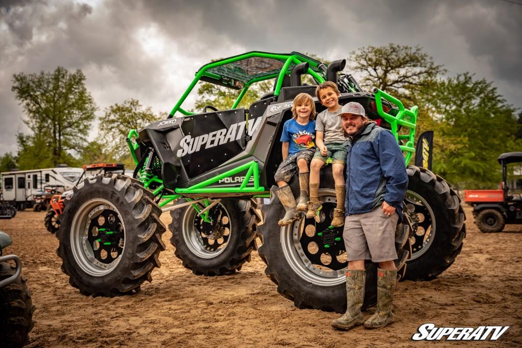 A family poses next to their custom Polaris machine.