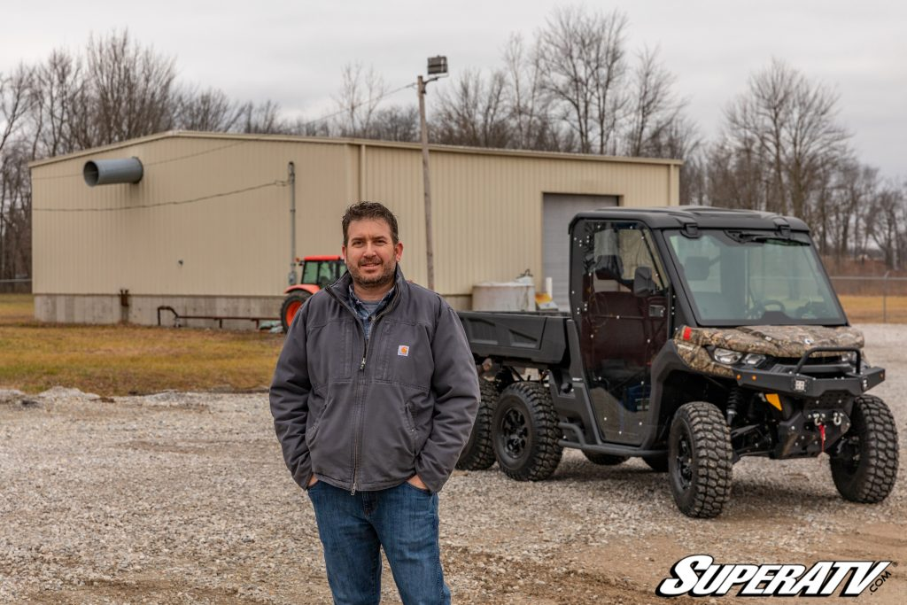 SuperATV employee Chuck Hensler with his 2020 Can-Am Defender