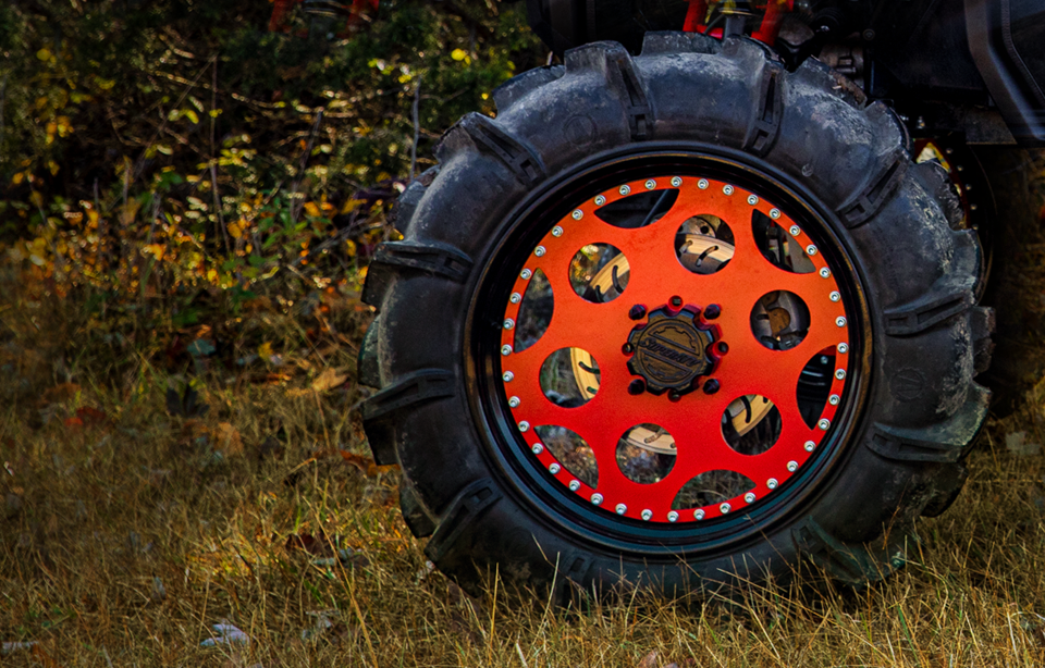 A T44 Series steel wheel from SuperATV with a Terminator tire