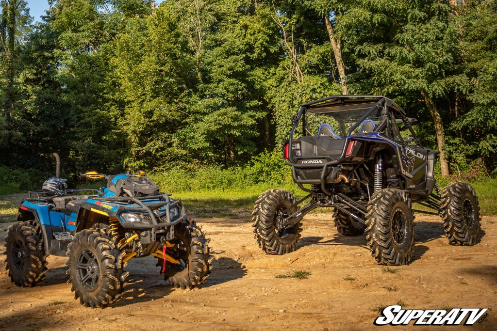 An ATV is parked next to a side-by-side