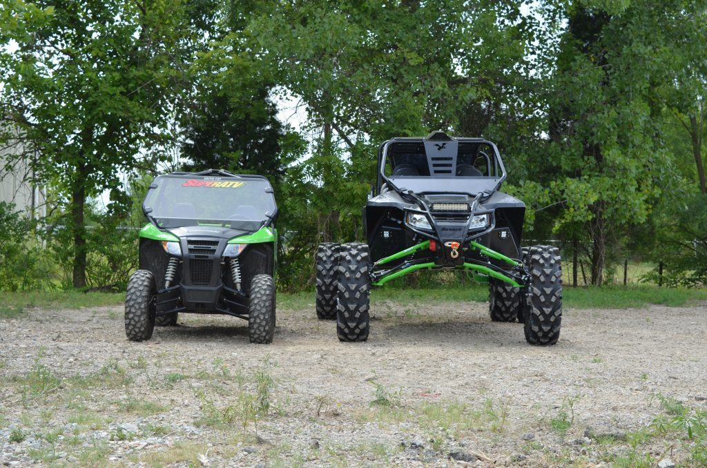 Side by side comparison of an Arctic Cat Wildcat with and without a custom lift kit.