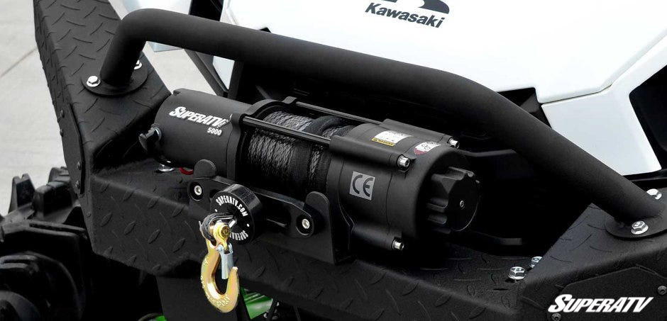 This close-up shot shows a SuperATV Black Ops Winch installed on a Kawasaki machine.