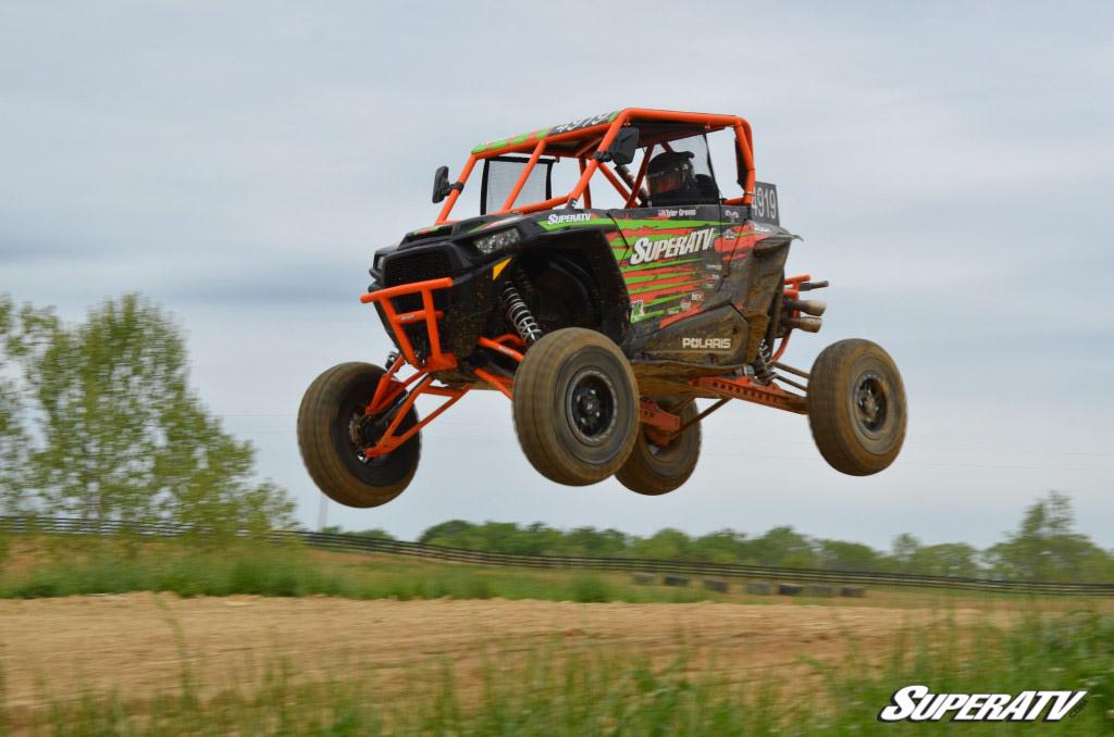 UTV jumping over dirt