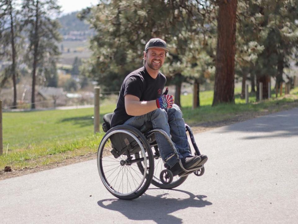 Buce cook doing a wheelie in his wheel chair