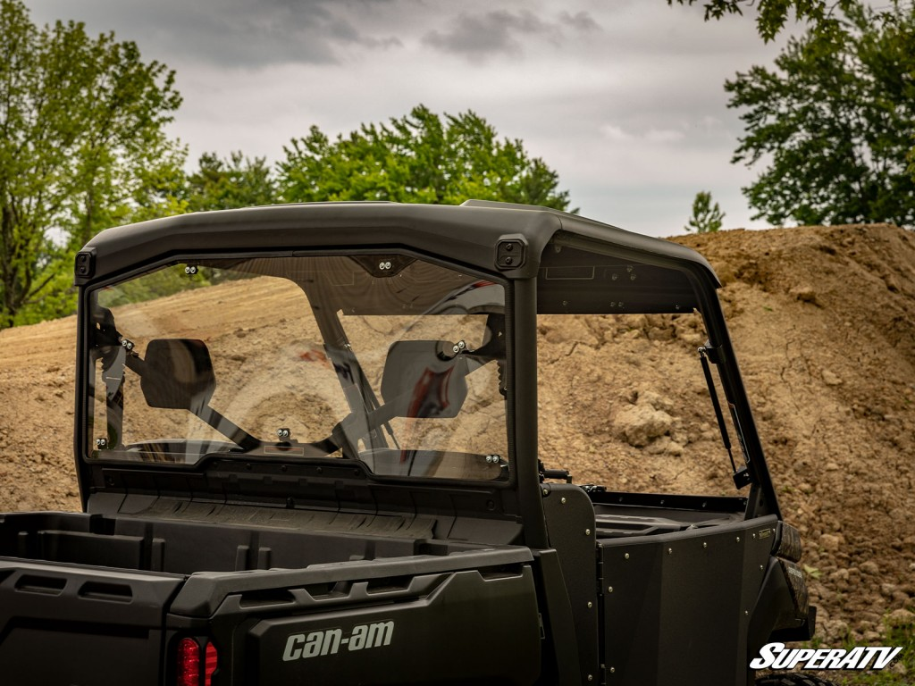 A rear windshield and front windshield are installed on a Can-Am Defender.