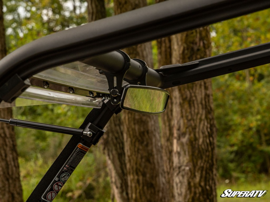 This is a close-up of a rear view mirror installed on a UTV. Adding mirrors to your machine greatly increases your visibility and is a must if you're planning on making your machine street legal.