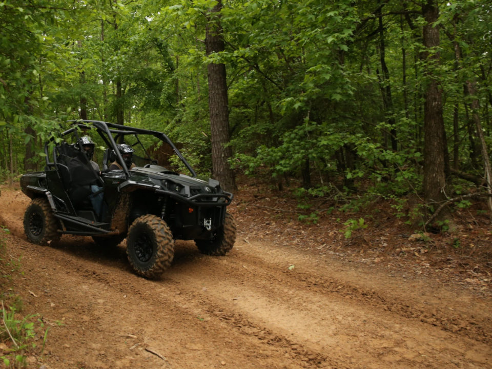 A 2021 Can-Am Commander going fast on a trail