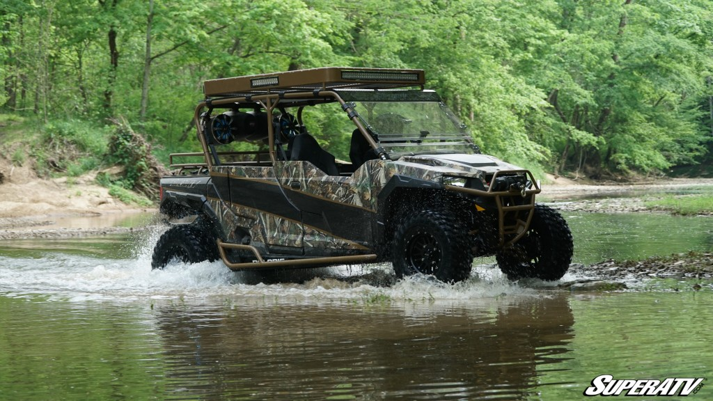 This photo shows Easton Corbin's custom General build (done by SuperATV) crossing a stream.