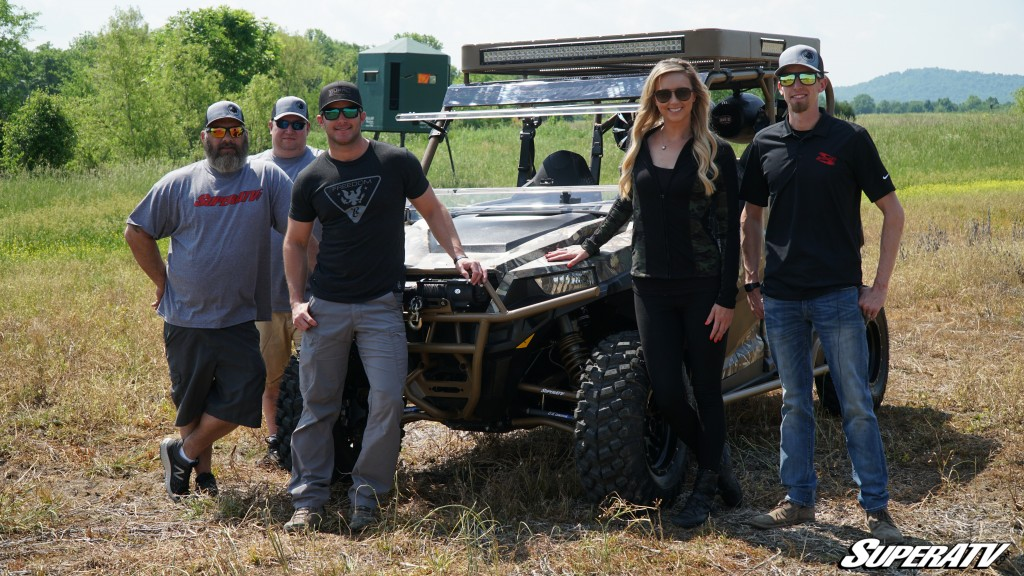 Easton Corbin poses with members of the SuperATV team and the Destination Polaris hosts in front of the custom General build.