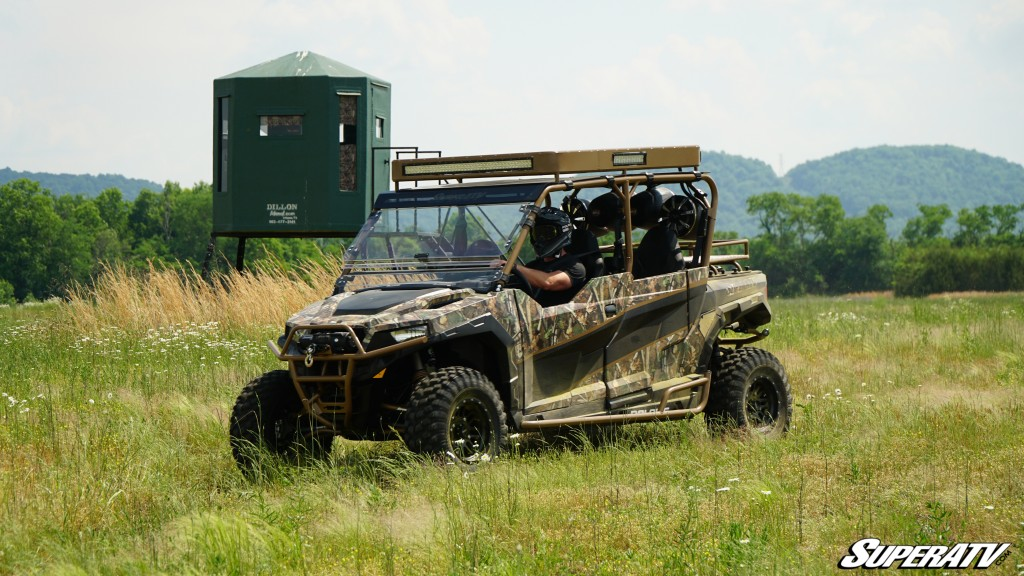 Easton Corbin sits behind the wheel of the custom Polaris General build that SuperATV created for him.