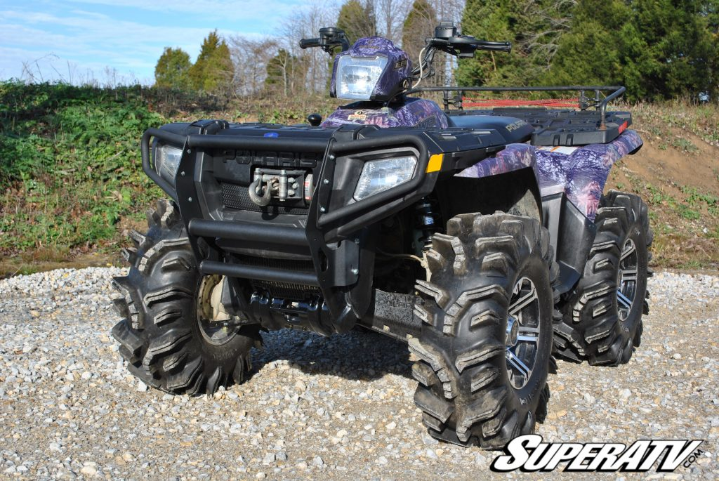 An ATV with a heavy front bumper and big aftermarket tires.