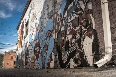 This photo shows artwork on a brick alley wall in downtown Madison, Indiana.