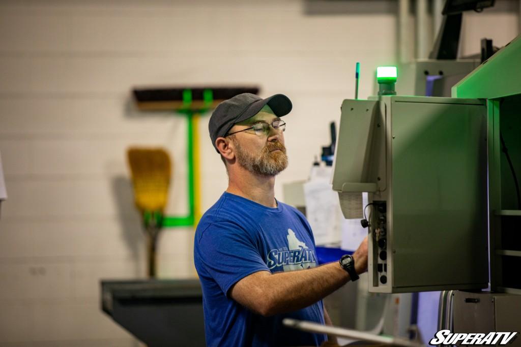 Doug Scott operates a CNC machine at SuperATV.