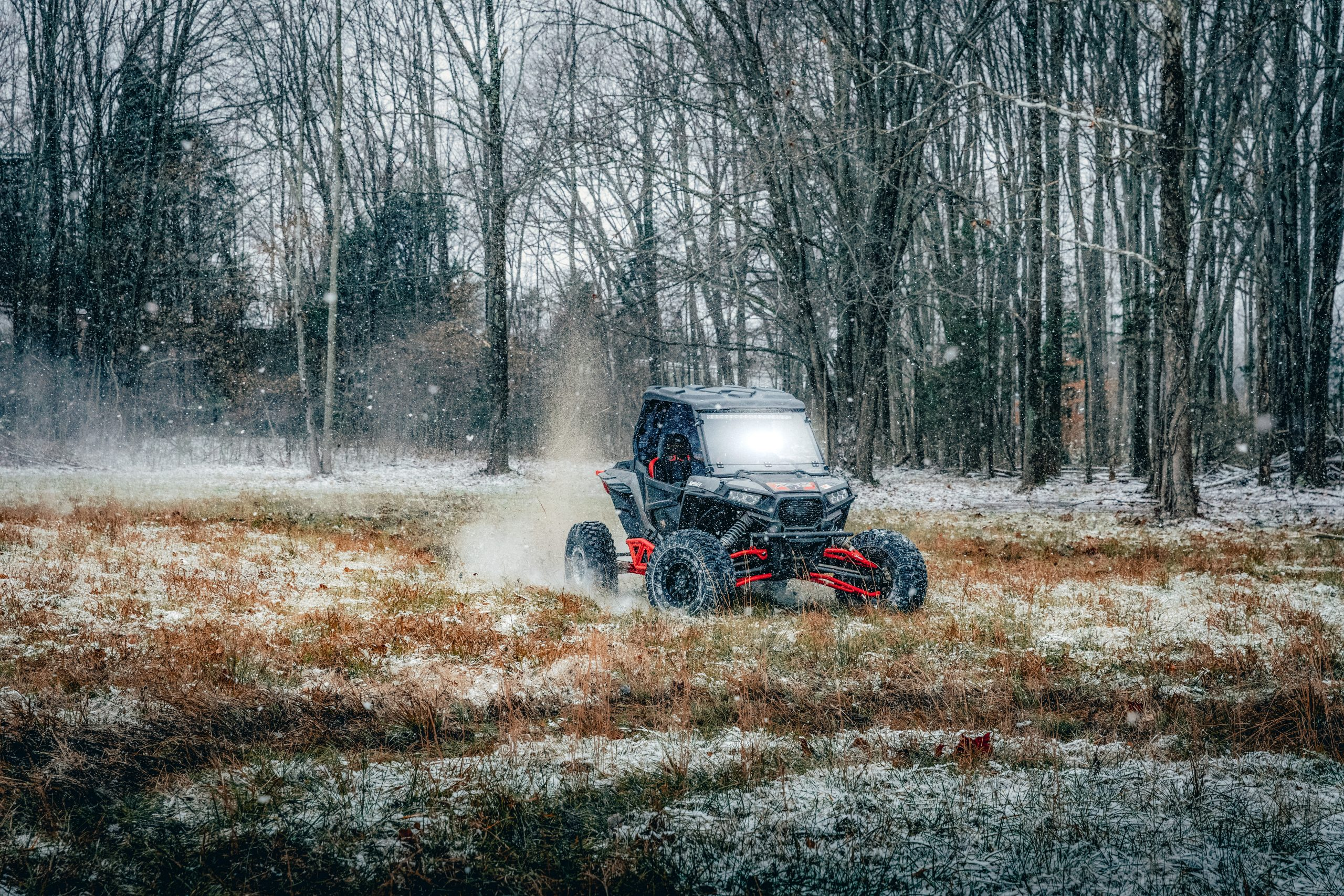A RZR Turbo with a roof, front windshield, and rear windshield makes riding in the winter comfortable and fun.