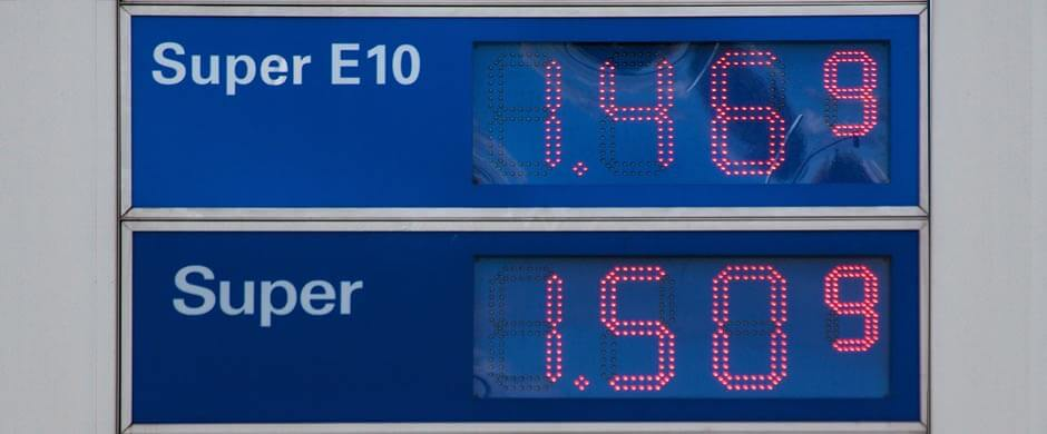 A gas price sign showing SuperE10 and Super
