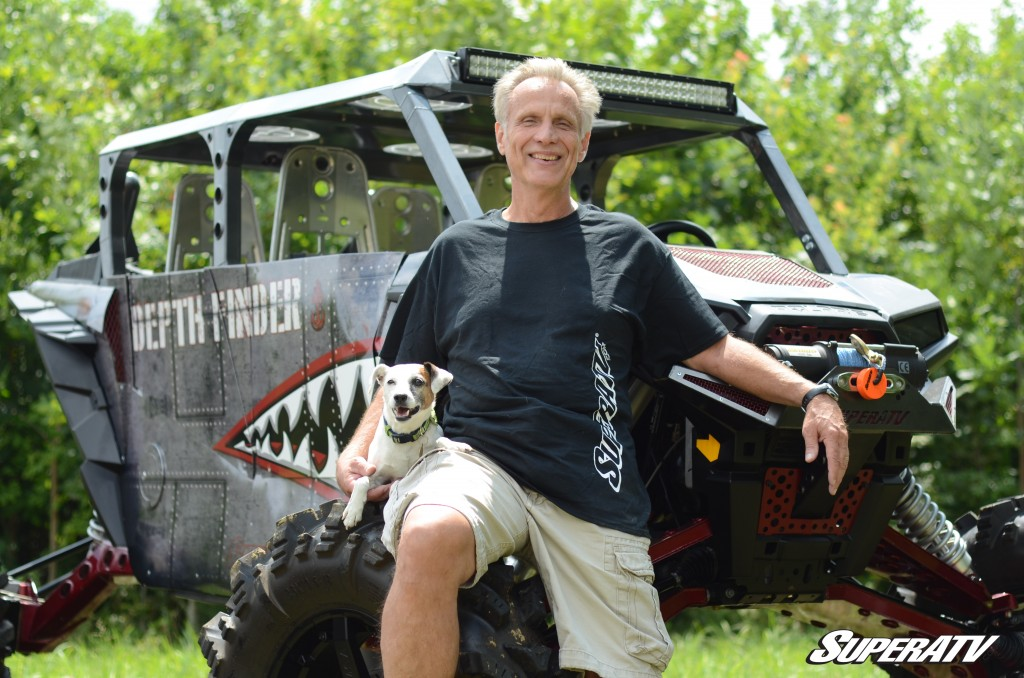 SuperATV founder and president Harold Hunt is pictured with his dog Bailey and the custom build Depth Finder.
