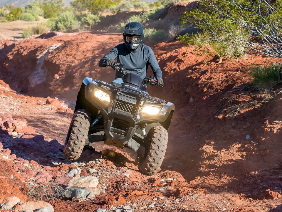 The Honda Rancher's specs allow it to navigate rocker terrain with ease.