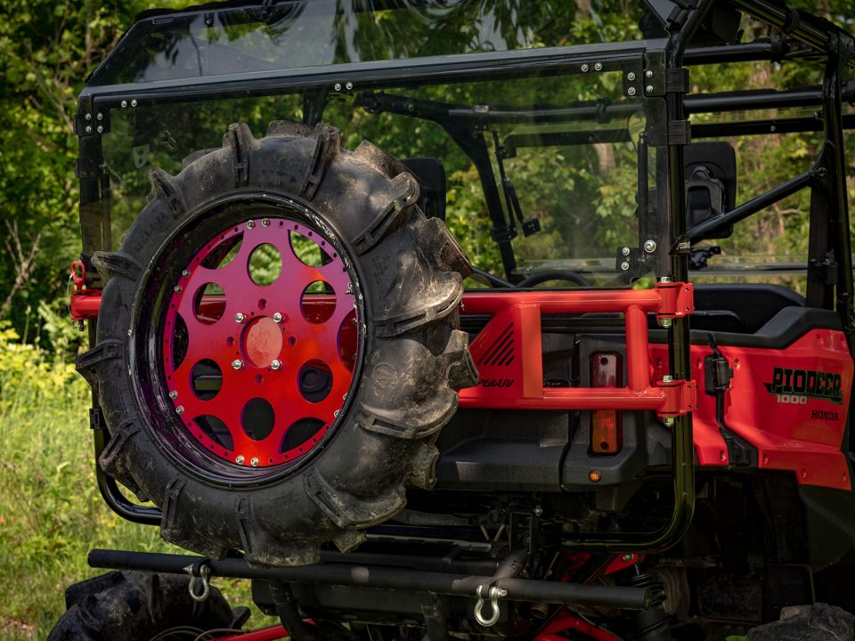 A spare tire carrier installed on a Honda Pioneer 1000-5