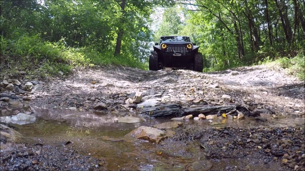 A Jeep approaches a creek crossing at Hot Springs ORV Park