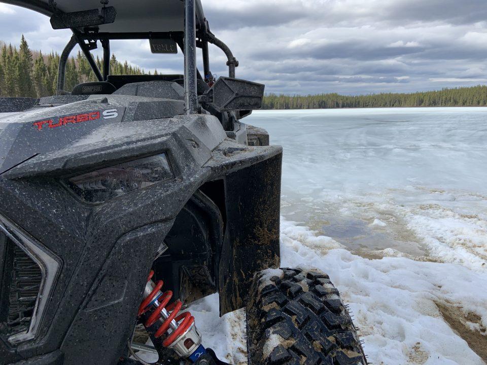 I Polaris RZR XP Turbo S by a frozen lake.