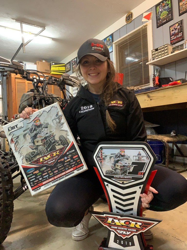 Kristen poses with her trophy from winning the 2019 IXCR Women's Advance Class Championship.