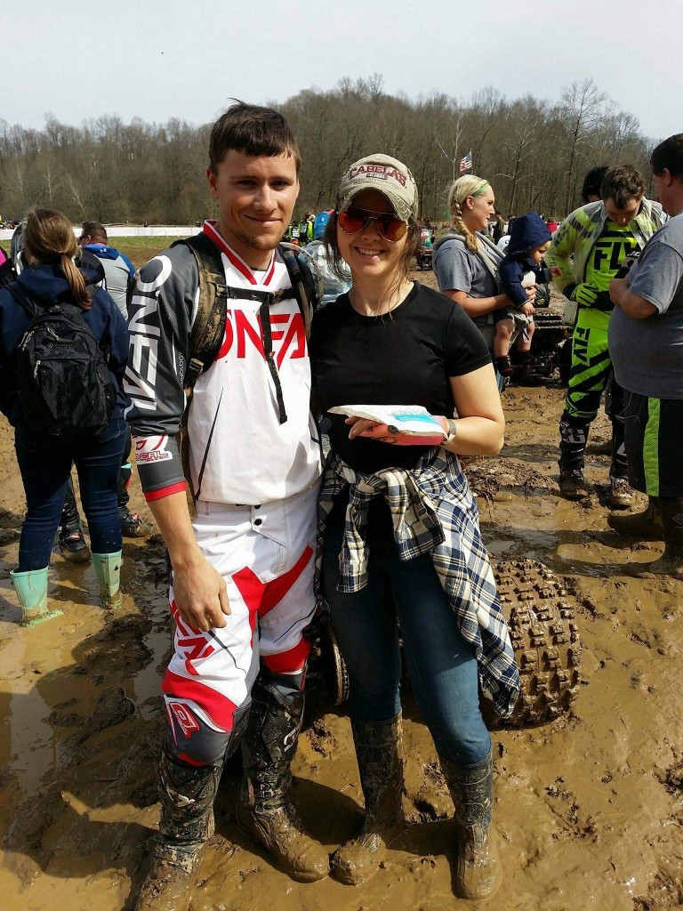 Kristen poses for a photo with her husband shortly after breaking her hand. The injury had her down for most of the 2018 racing season.
