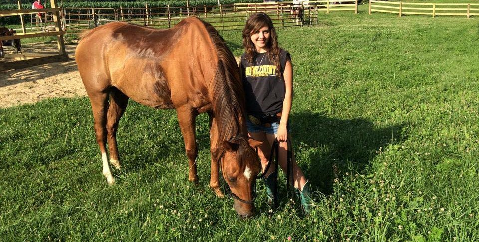 Kristen Smith poses with one of her horses.