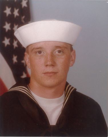 A headshot of Ron Lainhart from his years serving in the United States Navy