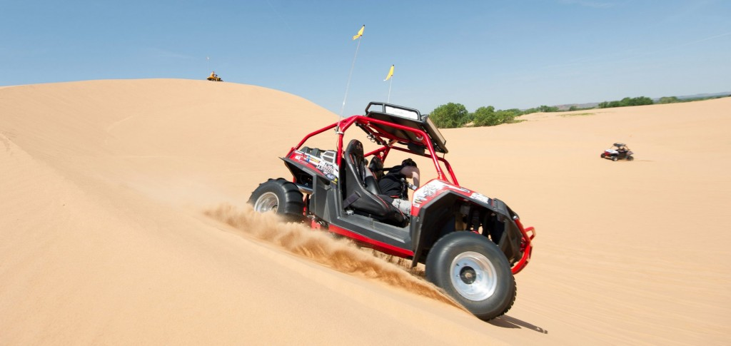 A side-by-side rides through the dunes at Little Sahara