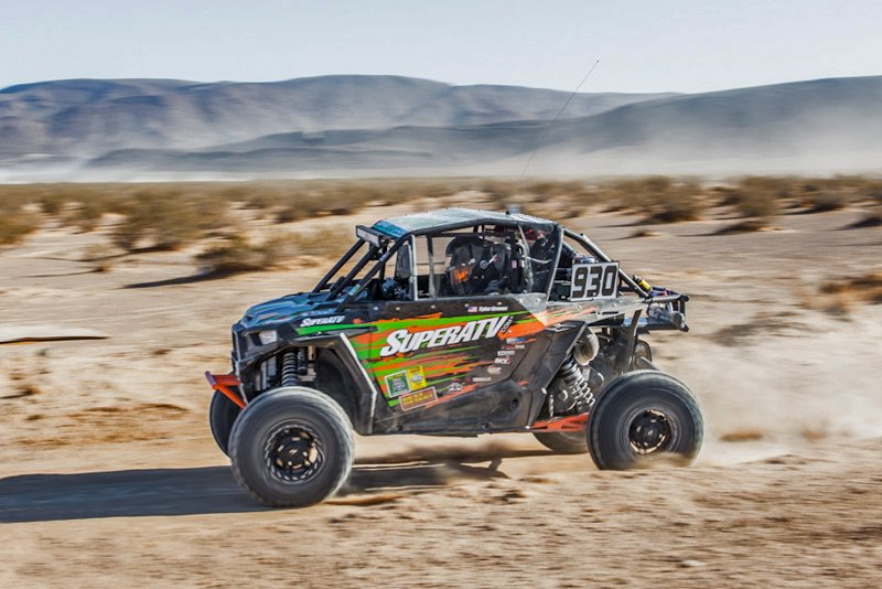A RZR Turbo in a high speed desert race.