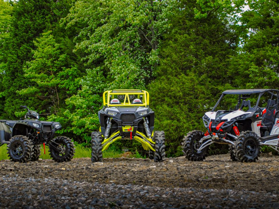 A Maverick, RZR and, Sportsman all with different parts
