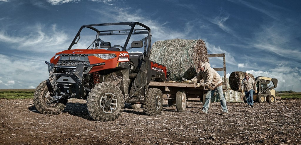 This photo from the official Polaris website shows workers utilizing their Ranger XP 1000 EPS to work on a farm.