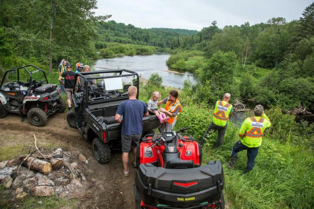 A group of riders stops for a break while riding at Renfrew County ATV Club