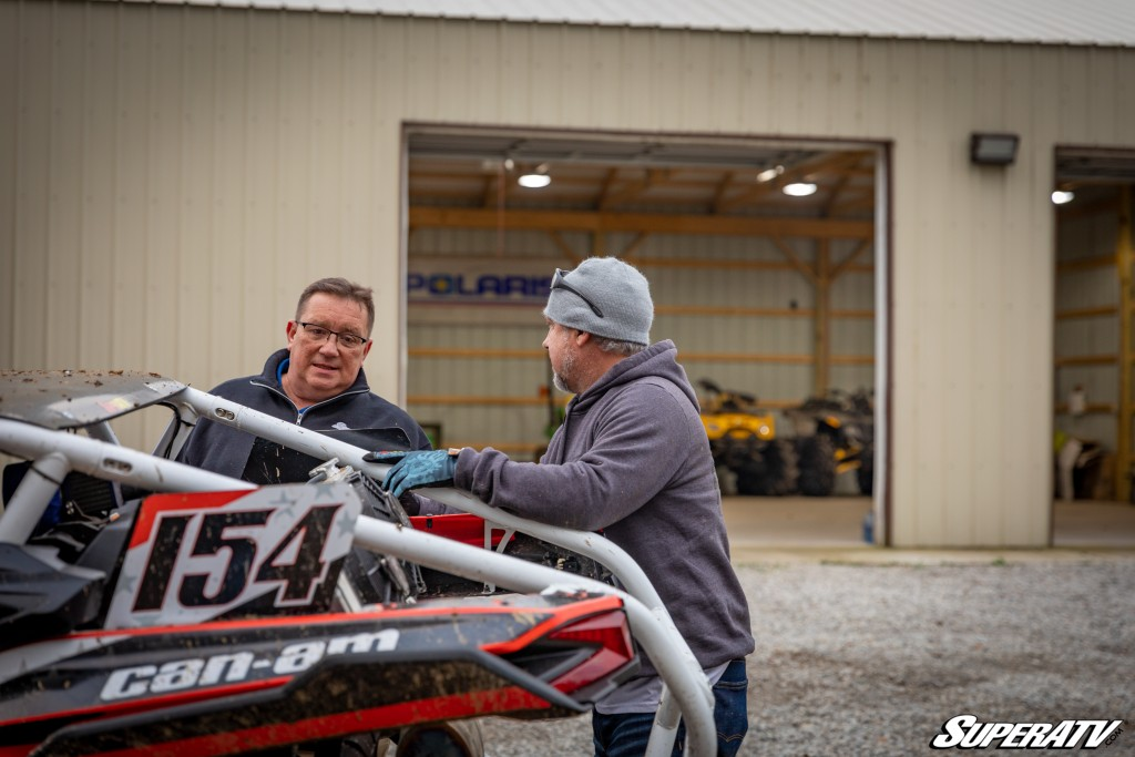 Ron Lainhart talks with another SuperATV employee while looking over a machine at the SuperATV headquarters in Madison, Indiana.