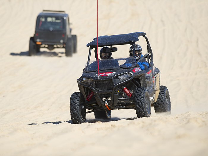 A UTV riding on the Silver Lake Sand Dunes.