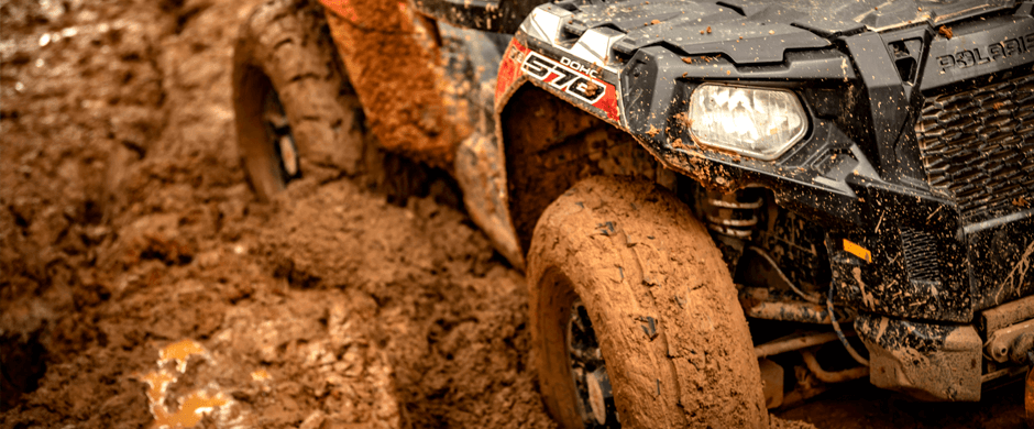 A RZR 570 getting stuck in the mud