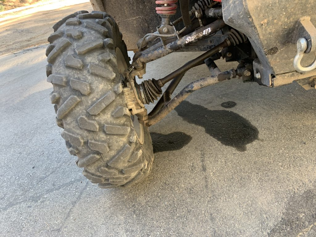 Close-up shot of the SuperATV A-arms on Jimmy's Teryx. They were still in perfect condition after hitting a bear.