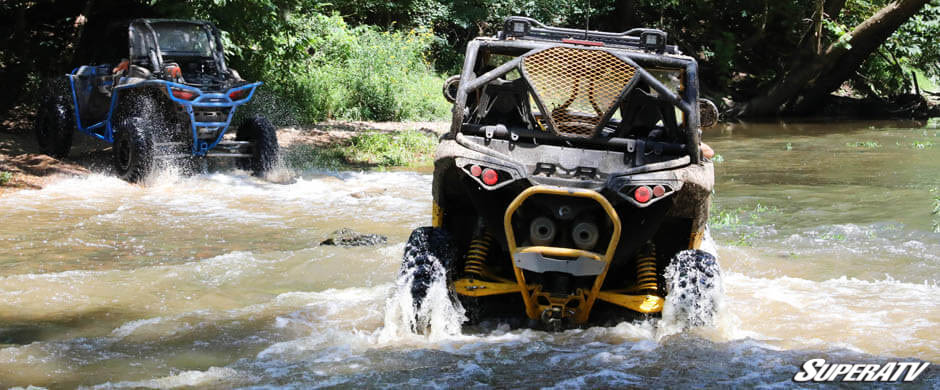 This photo shows two machines crossing Graham Creek during one of SuperATV's company rides.
