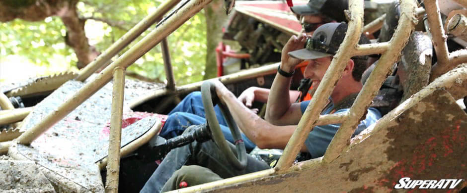 SuperATV racer Tyler Greves smiles from the driver's seat of the custom build Bad Blood.