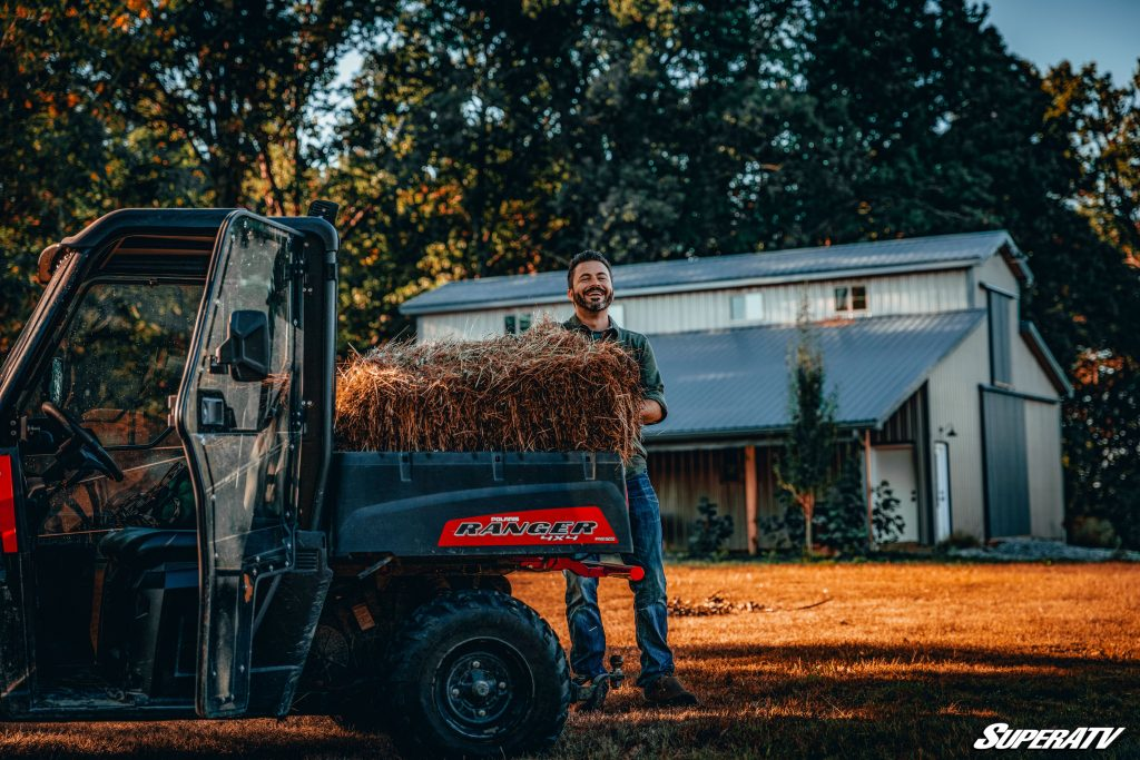 A Polaris Ranger is being used to haul hay around the farm