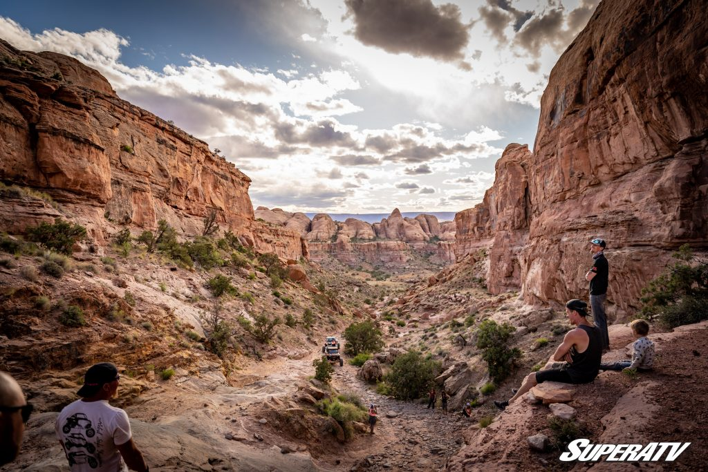 A group of people enjoying a valley in moab.