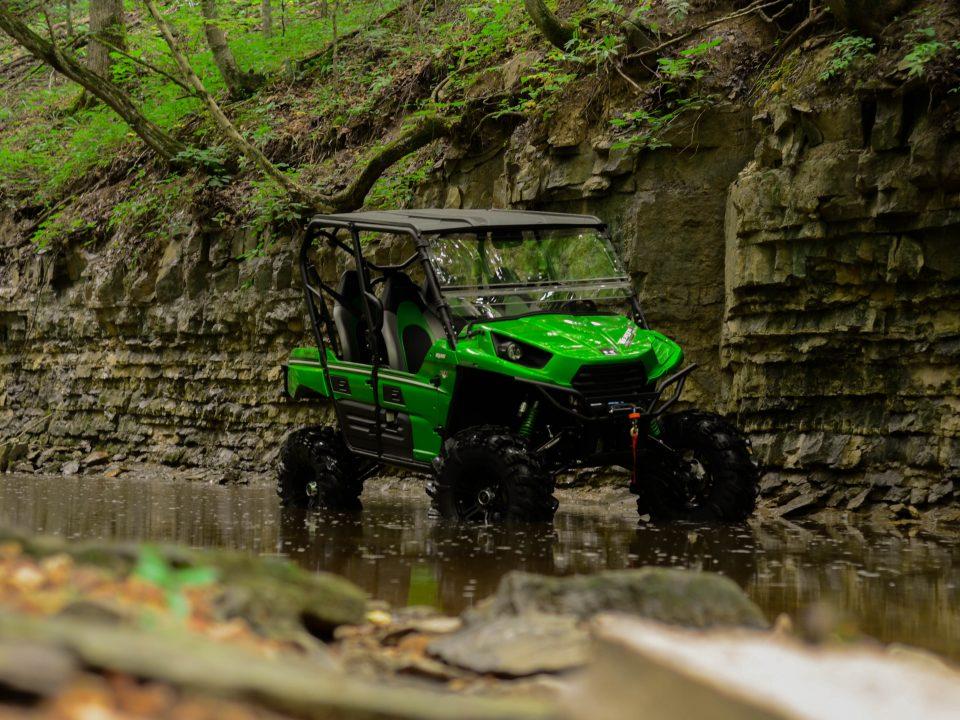 Kawasaki Teryx parked in a stream