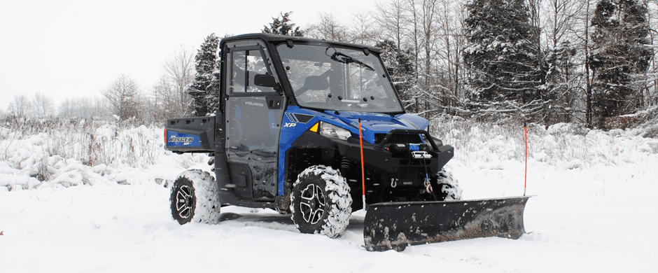 This Ranger is ready for winter with a fully enclosed cab, a winch, and plow.