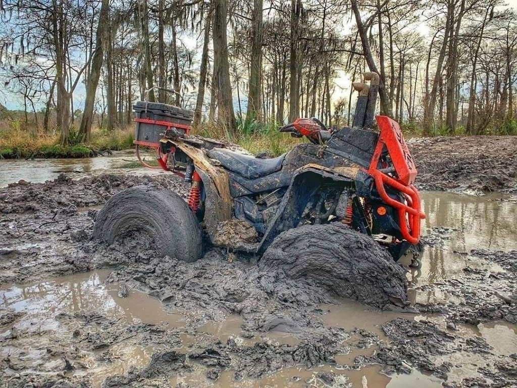 An ATV stuck in mud at Xtreme Off-Road Park & Beach