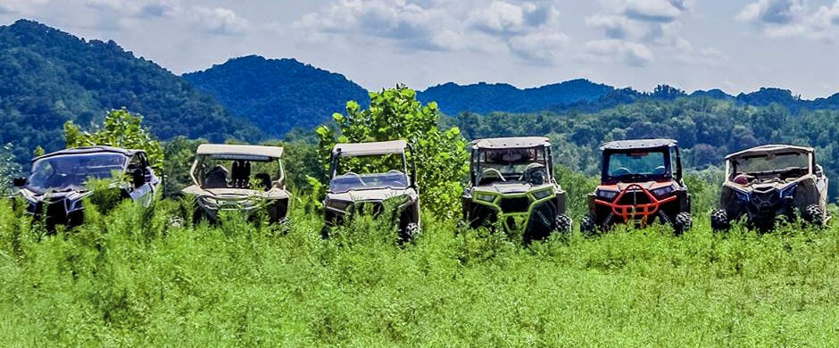 Adrenaline Junkies posing their UTVs for a picture