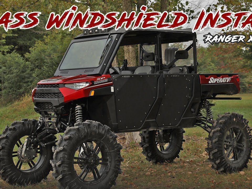 A Polaris Ranger XP 1000 with a SuperATV Glass Windshield installed